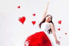 Beautiful brunette and hearts Royalty Free Stock Photography