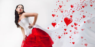 Beautiful brunette and hearts Stock Photos