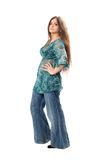 Beautiful brunette in hippy jeans. Full body shot of a beautiful brunette in hippy jeans Royalty Free Stock Images