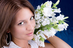 Beautiful brunette hold a bouquet white flowers Stock Images
