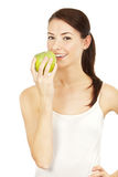 Beautiful brunette holding apple Stock Photos