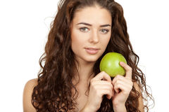 Beautiful brunette holding apple Stock Photography