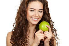 Beautiful brunette holding apple Stock Photos