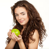 Beautiful brunette holding apple Stock Photo