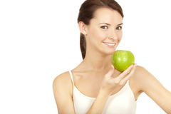 Beautiful brunette holding apple Stock Image
