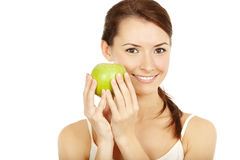 Beautiful brunette holding apple Royalty Free Stock Photography