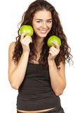 Beautiful brunette holding apples Stock Photo