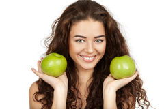 Beautiful brunette holding apples Royalty Free Stock Photography