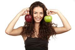 Beautiful brunette holding apples Royalty Free Stock Images