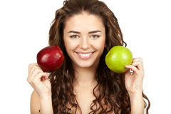 Beautiful brunette holding apples Royalty Free Stock Photos