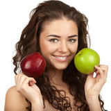 Beautiful brunette holding apples Stock Image