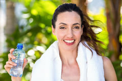 Beautiful brunette holding bottle of water Royalty Free Stock Photography