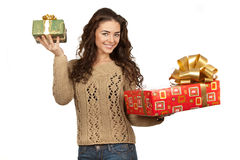 Beautiful brunette holding gifts Royalty Free Stock Images