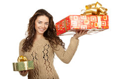 Beautiful brunette holding gifts Royalty Free Stock Photos
