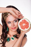 Beautiful Brunette Holding Half of fresh Grapefruit - Preference of Healthy Food. Woman Holding Half of fresh Grapefruit - Choose of Healthy Food Stock Photos