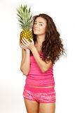 Beautiful brunette holding pineapple Royalty Free Stock Images
