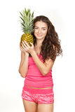 Beautiful brunette holding pineapple Royalty Free Stock Photography