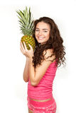 Beautiful brunette holding pineapple Royalty Free Stock Photos
