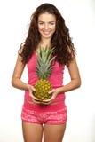 Beautiful brunette holding pineapple Royalty Free Stock Photo