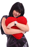 Beautiful brunette holding red heart Stock Image