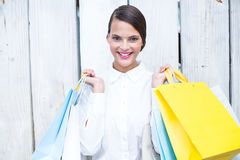 Beautiful brunette holding shopping bags Royalty Free Stock Photography