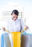 Beautiful brunette holding shopping bags Stock Photography
