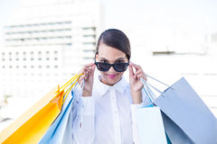 Beautiful brunette holding shopping bags Stock Photos