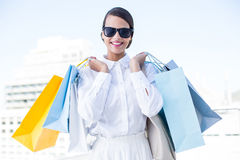 Beautiful brunette holding shopping bags Royalty Free Stock Image