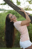 Beautiful Brunette Holding Tree Limb Royalty Free Stock Photography