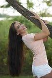 Beautiful Brunette Holding Tree Limb Royalty Free Stock Photography