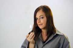 Beautiful Brunette Holds a Burning Match Royalty Free Stock Photo