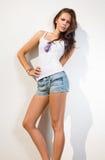 Beautiful brunette in hot summer sunshine. Royalty Free Stock Image