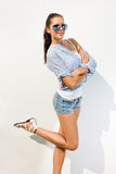 Beautiful brunette in hot summer sunshine. Royalty Free Stock Images