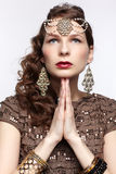 Beautiful brunette in jewellery Royalty Free Stock Photography