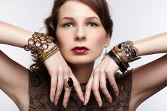 Beautiful brunette in jewellery Royalty Free Stock Images