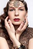 Beautiful brunette in jewellery Stock Photo