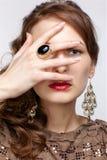 Beautiful brunette in jewellery Stock Photos