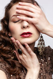 Beautiful brunette in jewellery Stock Photography