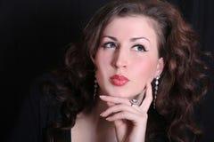 Beautiful brunette in jewelry. Portrait of a beautiful brunette in jewelry Head Shot Stock Photos