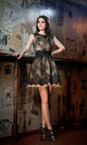 Beautiful brunette lady in elegant black lace dress posing in a vintage scene Stock Photography