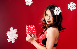 Beautiful brunette lady with gift Royalty Free Stock Photos