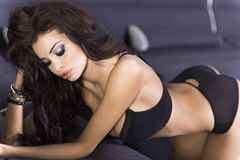 Beautiful brunette lady in lingerie. Stock Photo