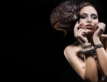 Beautiful brunette lady posing with amazing hairstyle. Stock Photography