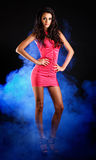 Beautiful brunette lady posing on dark background Royalty Free Stock Image