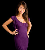 Beautiful Brunette Lady Posing in a Purple Dress Royalty Free Stock Photo