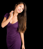 Beautiful Brunette Lady Posing in a Purple Dress Royalty Free Stock Photography