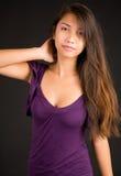 Beautiful Brunette Lady Posing in a Purple Dress Stock Photo