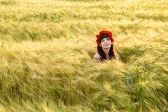 Beautiful brunette lady in wheat field. Stock Photo