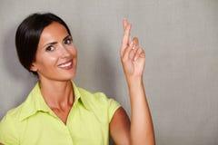 Beautiful brunette lady wishing crossing fingers Royalty Free Stock Photo