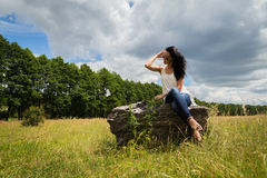 Beautiful brunette on a large boulder Stock Images